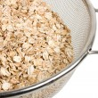 Oat in strainer — Stock Photo