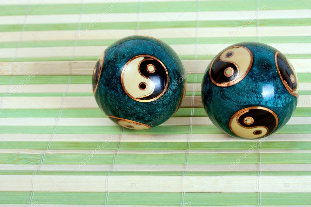 Pair chinese balls for relaxation on bamboo background — Stock Photo #10864808