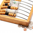 Abacus and dollar — Stock Photo