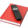 Phone on red organizer — Stock Photo