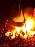 Saucepan on campfires — Stock Photo