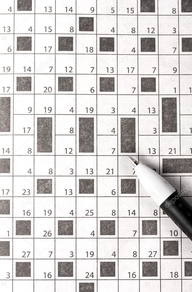 Crossword in newspaper concept and idea written pen — Stock Photo #11325461