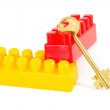 Key in plastic toy blocks - Stock Photo