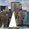 Boat with white sails on Hudson river - Stock Photo