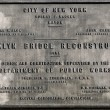 Stock Photo: Memorial plaque at Brooklyn Bridge, New York, USA.