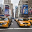 Stock Photo: NEW YORK - MAY 28: Group of yellow taxi cabs rush tourists aroun
