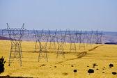 Power lines at desert — Stock Photo