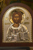 Golden Icon of Jesus Christ in brown frame — Stock Photo