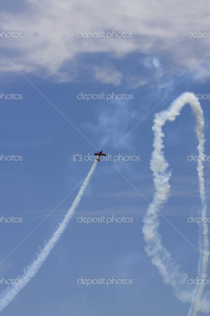 A plane performing in an air show at Jones Beach  Stock Photo #11296189