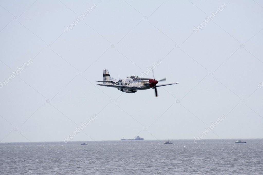 A plane performing in an air show at Jones Beach  Stock Photo #11296202