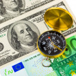 Stock Photo: Compass and money