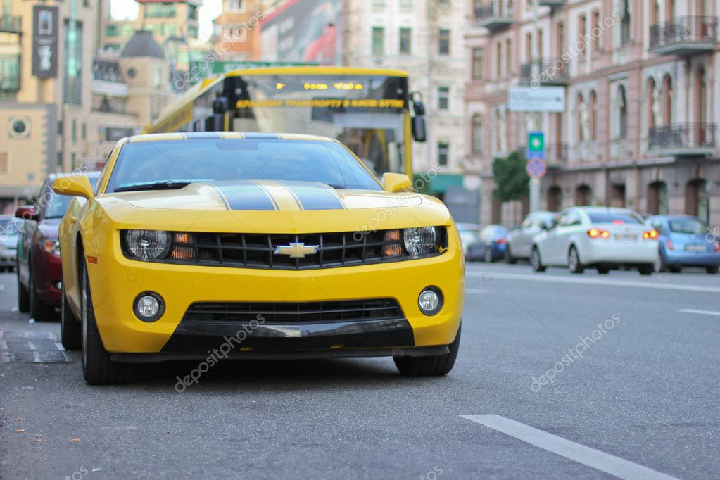 Yellow sport car on road in city — Stock Photo #11109778
