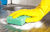 Hand with sponge — Stock Photo