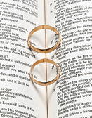 Wedding rings on a Bible — Stock Photo