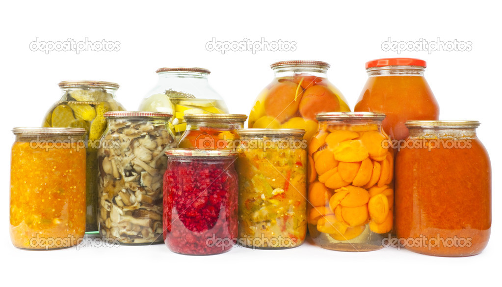 Collection of many glass bottles with preserved food on white background — Stockfoto #11156742