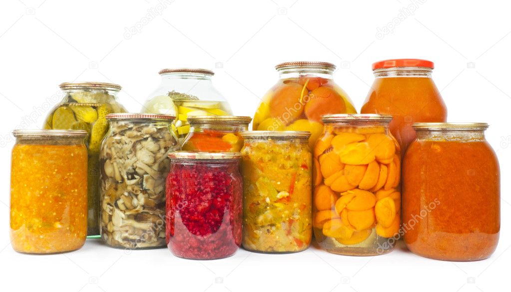 Collection of many glass bottles with preserved food on white background — Lizenzfreies Foto #11156742