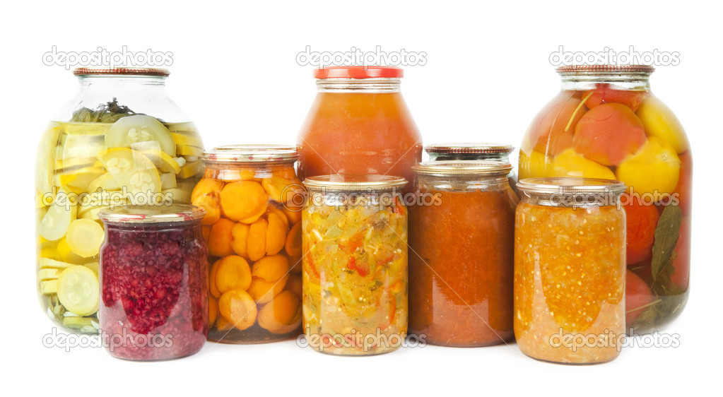 Collection of many glass bottles with preserved food on white background — Photo #11158475
