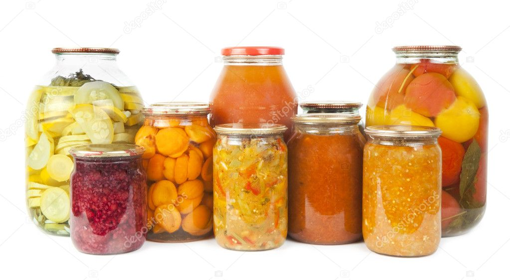 Collection of many glass bottles with preserved food on white background — Foto de Stock   #11158475