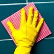 Hand with sponge - Stock Photo