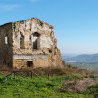 Farmhouse ruin among rural landscape — Stock Photo