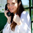 A woman is talking on the phone — Stock Photo #11235078