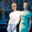 Mannequins in the showcase — Stock Photo