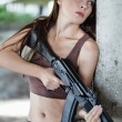 Stock Photo: Womwith rifle (AK-74)