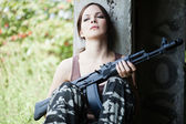 Woman with rifle (AK-74) — Stock Photo