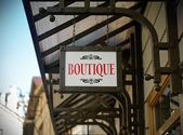 Boutique shop sign — Stock Photo