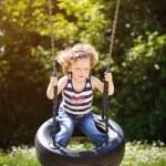 Little girl is swinging — Stock Photo