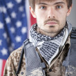 Soldier over american flag — Stock Photo