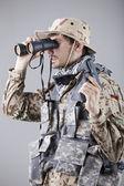 Soldier looking through binoculars — Stock Photo
