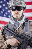 Soldier with gun over american flag — Stock Photo