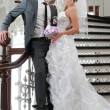 Wedding couple on stair — Photo