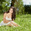 Young girl chilling in green park outdoors — Stock Photo
