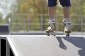 Skater in aggressive in-line rollerblades — Stock Photo