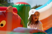 Cute little girl in a jumping castle — Stock Photo