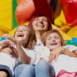 Mother and her daughters having fun on jumping castle — Stock Photo #11426823