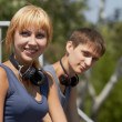 Young positive teenagers with headphones — Stock Photo