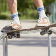 Skater doing noseslide on fun-box in skatepark — Stock Photo