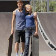Teen skaters with boards in skatepark - Stock Photo