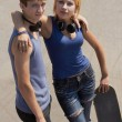 Stock Photo: Young skaters with boards posing