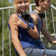 Punk girl skater sitting on a ramp — Stockfoto
