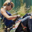 Stock Photo: Young punk girl skater in headphones