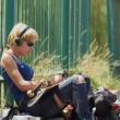 Young punk girl skater in headphones — Stock Photo #11457675