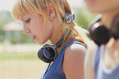 Young attractive punk girl with wireless headphones — Stock Photo