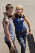 Young skaters with boards posing — Stock Photo