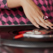 Hands of female DJ mixing music — Stock Photo #11619366
