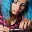 Постер, плакат: Punk girl DJ with dyed turqouise hair