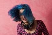 Punk girl DJ with dyed turqouise hair — Стоковое фото